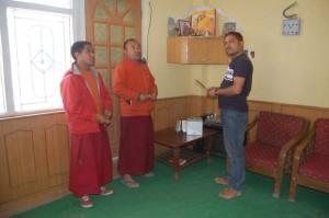 Pooja by Buddhist Lamas inside Kay Cee lodge, kaza, Spiti